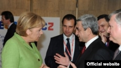 Armenia - Serzh Sarkisian, President of Armenia, and Angela Merkel, Chancellor of Germany, at the EU Eastern Partnership Summit, Prague,07May2009