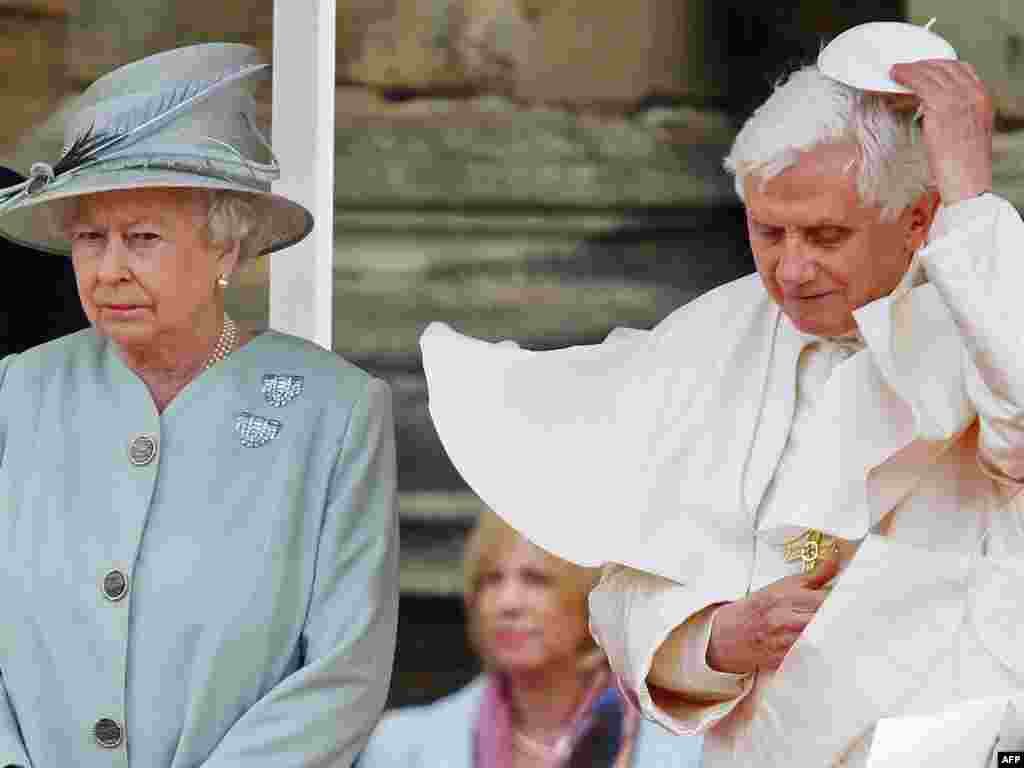 The queen meets with the head of the Roman Catholic Church, Pope Benedict XVI, in September 2010.