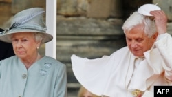 Queen Elizabeth II meets with Pope Benedict XVI in a blustery Edinburgh.