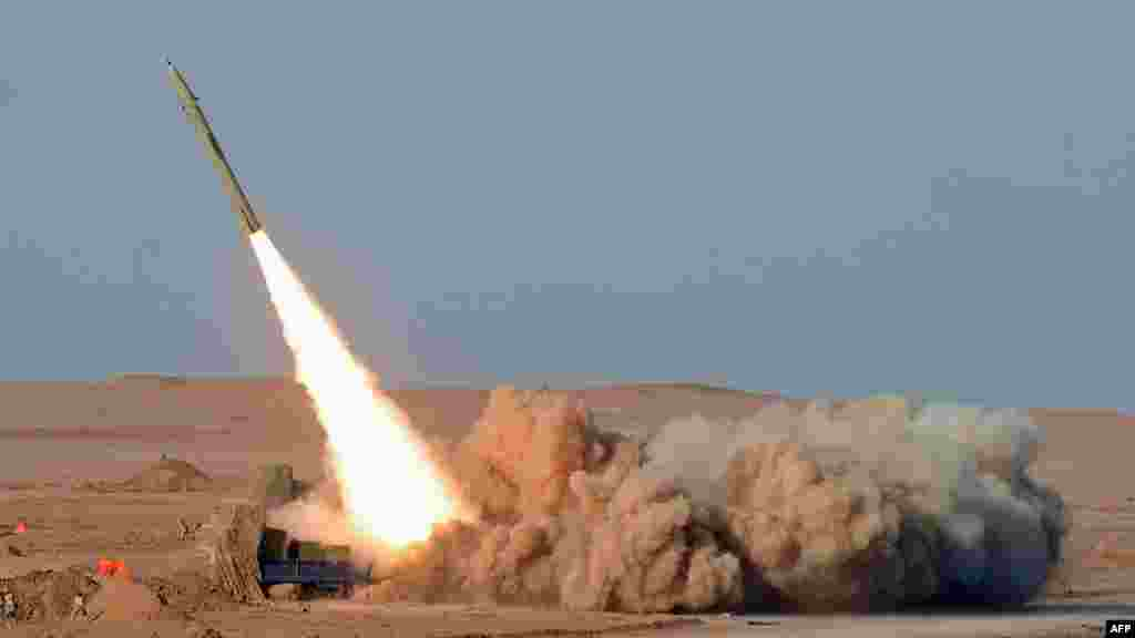A short-range missile is launched during the second day of military exercises, code-named Great Prophet 7, for Revolutionary Guards in Iran's Kavir Desert on July 3. (AFP/ISNA/Arash Khamoushi)