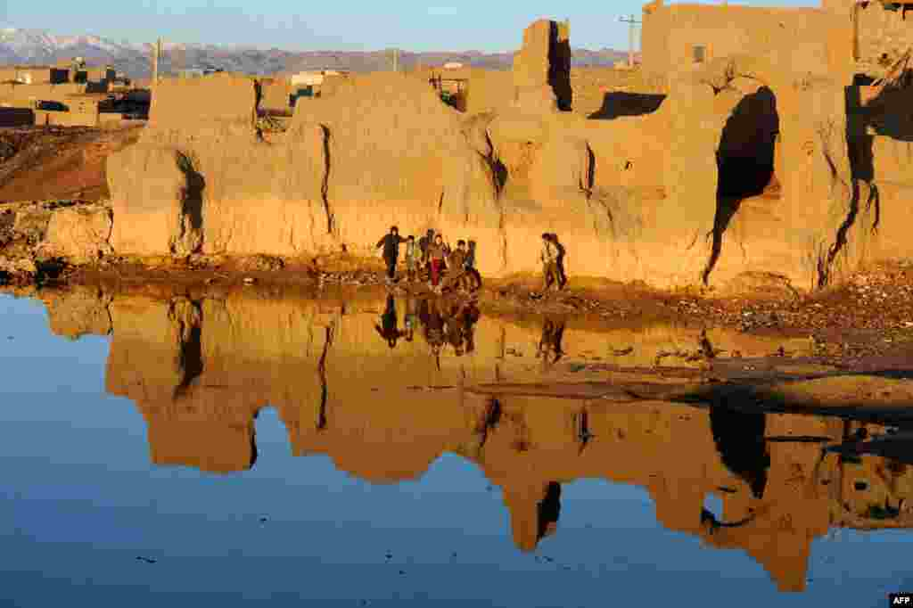 Afghan children play near a lake on the outskirts of the western city of Herat. (AFP/Aref Karimi)