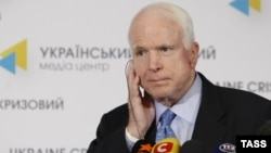 U.S. Senator John McCain gives a press conference in Kyiv in September 2014.