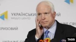U.S. Senator John McCain gives a press conference in Kyiv in September 2014.