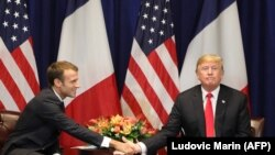 French President Emmanuel Macron (L) shakes hands with U.S. President Donald Trump at the start of a bilateral meeting in New York, September 24, 2018
