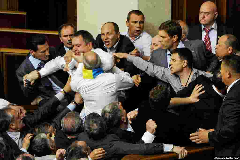 In a good candidate for the accidental renaissance photography genre, a brawl erupts during a debate on a Russian-language bill in March 2012.