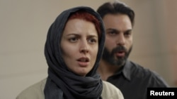 "Leila Hatami (left) and Peyman Moadi in a scene from the Oscar-nominated Iranian film ""A Separation."""