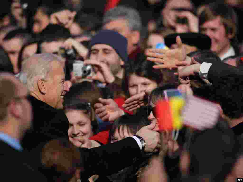 U.S. Vice President Joe Biden greets people in the Moldovan capital, Chisinau, on March 11. Biden is the highest-ranking U.S. official ever to visit Moldova, Europe's poorest country. (AFP/Vadin Denisov)