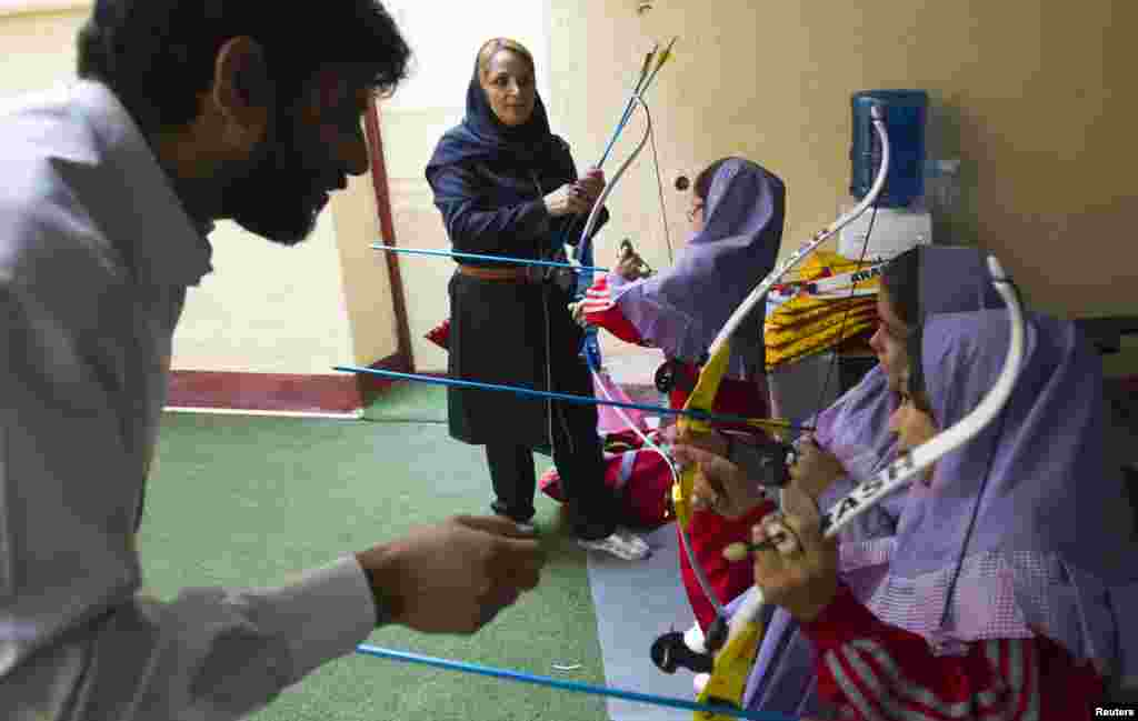 Students learn archery at the Pishtaz School in Tehran, a preschool for gifted children.