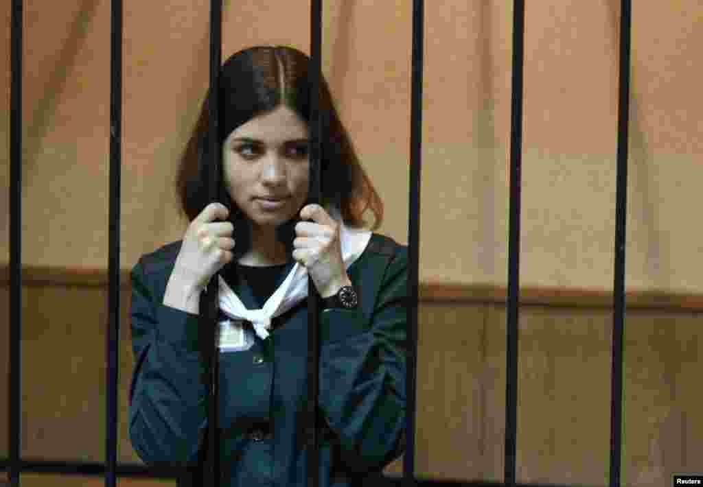 Pussy Riot band member Nadezhda Tolokonnikova looks out from a holding cell during a court hearing on her parole request in the Russian town of Zubova Polyana. Tolokonnikova is appealing her conviction for hooliganism motivated by religious hatred for which she is serving two years in a remote penal colony. (Reuters/Mikhail Voskresensky)
