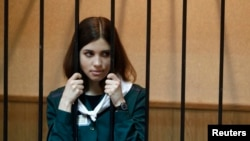 Nadezhda Tolokonnikova looks out from a holding cell during her court hearing on April 26.