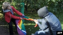 "A rights activist (left) is set upon by against an antigay protester during a gay-pride event in St. Petersburg. Russia's ""gay propaganda"" law has been blamed for unleashing a wave of homophobia across the country."