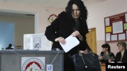 A woman casts her vote at a polling station in South Ossetia's Tskhinvali on March 25.