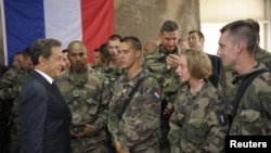 French President Nicolas Sarkozy (left) speaks with French troops deployed in Tora, Afghanistan, earlier this year.