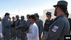 Ауғанстан полицейлері. Гильменд уәлаяты, 25 маусым 2012 жыл. (Көрнекі сурет).