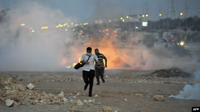 Egyptian supporters of the deposed president, Muhammad Morsi, run from a fire during clashes with security forces in Six October City in Giza, south of Cairo, on August 2.