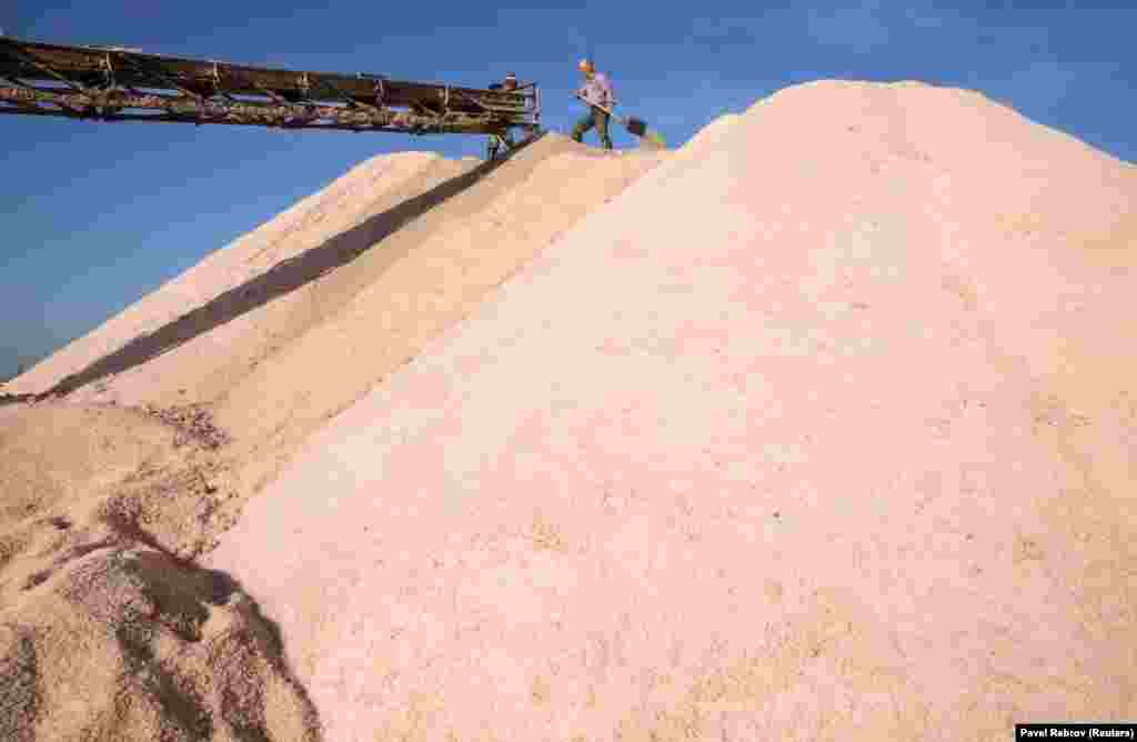 A mountain of pink salt is collected for processing.