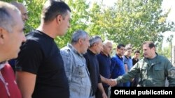 Armenia -- Defense Minister Davit Tonoyan (R) greets reservists called up for military exercises, September 24, 2019.