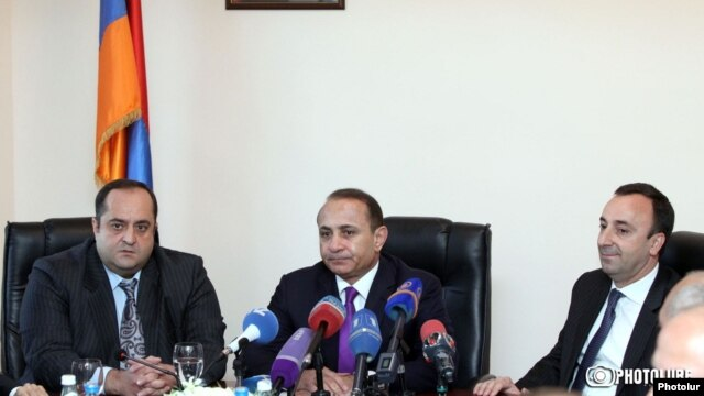 Armenia - Newly appointed Justice Minister Hovannes Manukian (L) is introduced to his staff by Prime Minister Hovik Abrahamian (C) in the presence of his predecessor Hrayr Tovmasian, Yerevan, 5Mar2014.