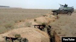 An undated photo of Azerbaijani soldiers taking part in military exercises.