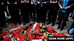 Mourners pray after laying wreaths near the site of the Reina nightclub massacre in Istanbul, which left 39 people dead.