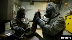 The Organization for the Prohibition of Chemical Weapons, the international group overseeing the removal and destruction of Syria's chemical arsenal, says that less than 5 percent of the chemicals declared by Syria have been removed so far. (file photo)