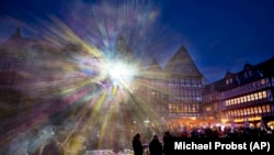 Light shines from one of the buildings at Roemer Square during the official opening of the Luminale light festival in Frankfurt, Germany. (AP/Michael Probst)