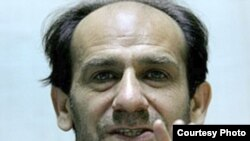 "Iranian writer and journalist Ahmad Gholami, who was arrested in after a raid on the newspaper ""Shargh"" on December 7."