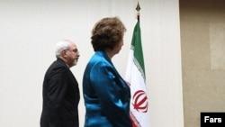 محمدجواد ظریف، وزیر خارجه جمهوری اسلامی ایران و کاترین اشتون، مسئول سیاست خارجه اتحادیه اروپا. در ژنو سوئیس.