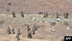 FILE: Pakistani troops climb a hill in Ladha, a rural region in South Waziristan district.