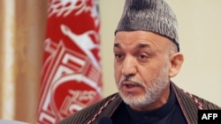Afghan President Hamid Karzai announces his assets during a press conference in Kabul.