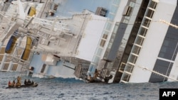 """A file photo of rescue efforts next to the stricken cruise liner """"Costa Concordia"""" days after it was run aground"""