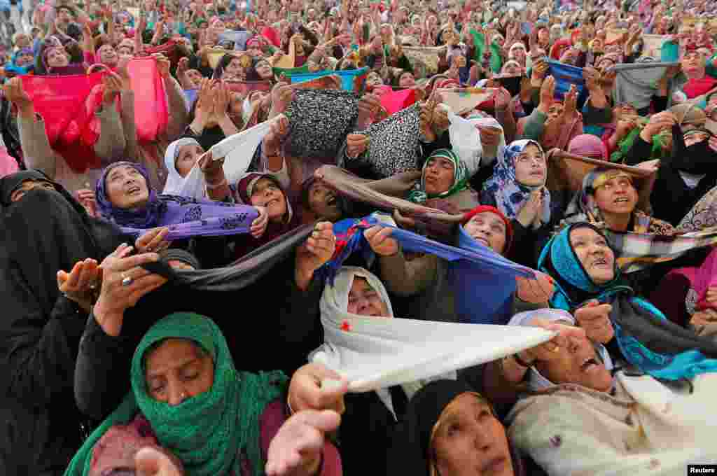 Kashmiri Muslim women pray upon seeing a relic believed to be hair from the beard of the Prophet Muhammad during Meeraj-un-Nabi, a festival marking the ascension of the Prophet to heaven, at the Hazratbal shrine in Srinagar. (Reuters/Danish Ismail)