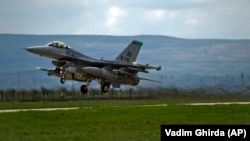 A U.S-made F-16 fighter jet takes off from an air base in Romania.