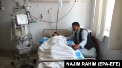 An Afghan Local Police member injured in Taliban attack in Qala-e-Zal district of Kunduz province receives medical treatment at a hospital in Mazar-e-Sharif on June 9.