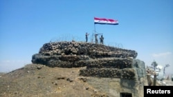Syrian forces of President Bashar al-Assad on al-Haara hill in the Quneitra area.