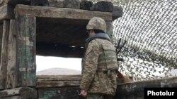 Armenia - An Armenian soldiers guards the border with Azerbaijan's Nakhichevan exclave, 27Nov2013.