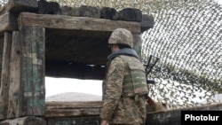 Armenia - An Armenian soldiers guards the border with Azerbaijan's Nakhichevan exclave, 27Nov2013.
