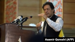 Pakistani Prime Minister Imran Khan addresses the legislative assembly in Muzaffarabad on August 14.