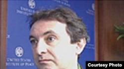 Тим Џуда, британски новинар