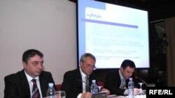 Tengiz Sharmanashvili (left) and Avtandil Demetrashvili (right) at the commission meeting in Tbilisi on May 11.