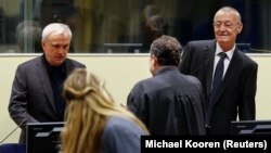 Jovica Stanisic (left) and Franko Simatovic (far right) appear in court for their retrial at the United Nations Mechanism for International Criminal Tribunals in The Hague on June 13.