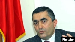 Armen Rustamian, announces the Amenian Revolutionary Federation's departure from the governing coalition on April 27, 2009.