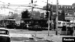 Burned trams and cars in the center of Sarajevo after heavy shelling by Bosnian Serb forces in May1995