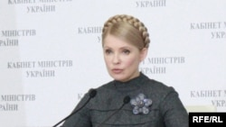 "Prime Minister Yulia Tymoshenko described her opponents' wealthy backers as an ""oligarchic plague of locusts."""