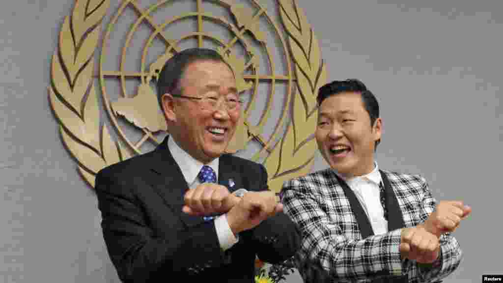 "South Korean singer Psy (right) practices some ""Gangnam Style"" dance steps with UN Secretary-General Ban Ki-moon during a photo opportunity at the UN headquarters in New York. (Reuters/Eduardo Munoz)"