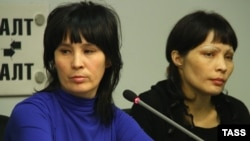 "Bakiya Kasymova (left) and Leila Ashirova, both recently freed from captivity, talk to reporters in connection with a recent ""slavery"" scandal involving migrant workers in Moscow."