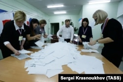 Counting votes at polling station No. 384 in Russia's Far East Sakhalin region, where voting has ended.