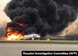 The Russian-made Sukhoi Superjet SSJ100 on fire on the runway in Moscow