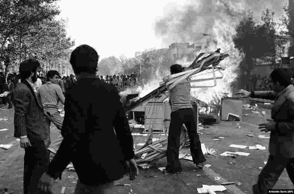 Protesters set fires on the streets of the Iranian capital during antigovernment demonstrations on November 5, 1978. Protests turned deadly later that month when armed soldiers clashed with students at the University of Tehran.