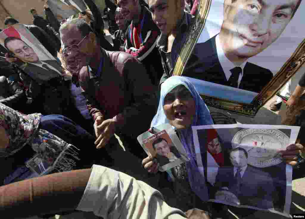 Supporters of Egypt's former President Hosni Mubarak shout slogans on February 22 outside the Cairo police academy where his trial is scheduled to take place. (REUTERS/Amr Abdallah Dalsh)